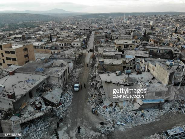 An aerial view taken on December 8, 2019 shows the damage caused by reported Syrian regime and Russian air strikes the previous day in the town of...