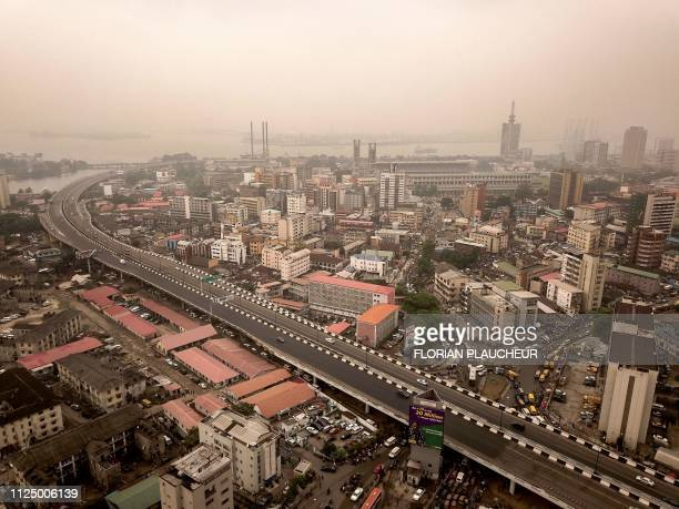 An aerial view taken on February 12, 2019 shows the historic centre of Lagos, the economic capital of Nigeria, with the harbour in the background. -...