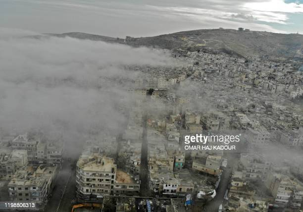 An aerial view taken on February 5 shows the rebel-held town of Ariha in the northern countryside of Syria's Idlib province following an air strike...