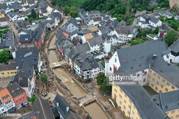 An aerial view taken on July 16, 2021 shows the destruction in the pedestrian area of Bad Muenstereifel, western Germany, after heavy rain hit parts...
