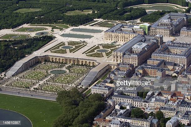 An aerial view taken on June 2 shows the Chateau de Versailles and its gardens, west of Paris, whose construction began in 1661, by architect Louis...