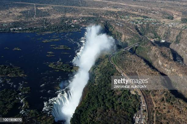 An aerial view taken on June 29, 2018 shows the site of the Victoria Falls on the Zambezi River at the border between Zambia and Zimbabwe.