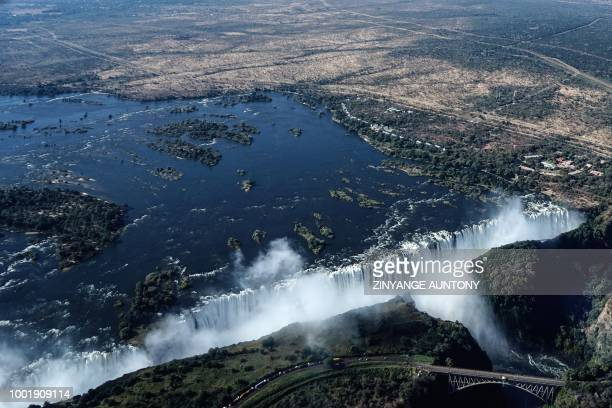 An aerial view taken on June 29 2018 shows the site of the Victoria Falls on the Zambezi River at the border between Zambia and Zimbabwe