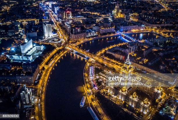An aerial view taken with a drone on late August 12 2017 shows the Radisson Royal Hotel opposite the Russian government headquarters as boats pass on...