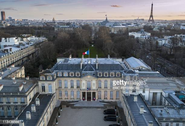 An aerial view taken on March 11, 2019 in Paris shows the Elysee Palace , the official residence of the French President, and on the background the...