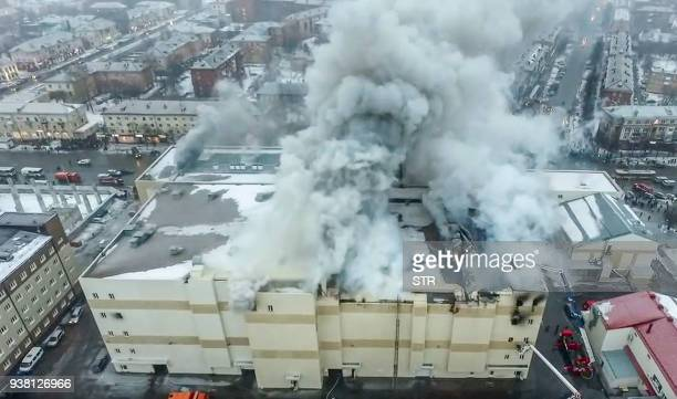 An aerial view taken on March 25 2018 with a drone shows a fire of the shopping centre in Kemerovo A total of 64 people many of them children...
