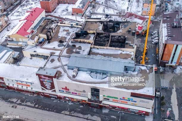 An aerial view taken with a drone on March 27 2018 shows a multistorey shopping mall after it was gutted by a fire in the industrial city of Kemerovo...
