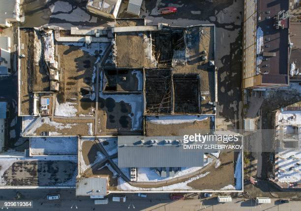 An aerial view taken with a drone on March 29 2018 shows a shopping mall after it was gutted by a fire in the industrial city of Kemerovo in western...