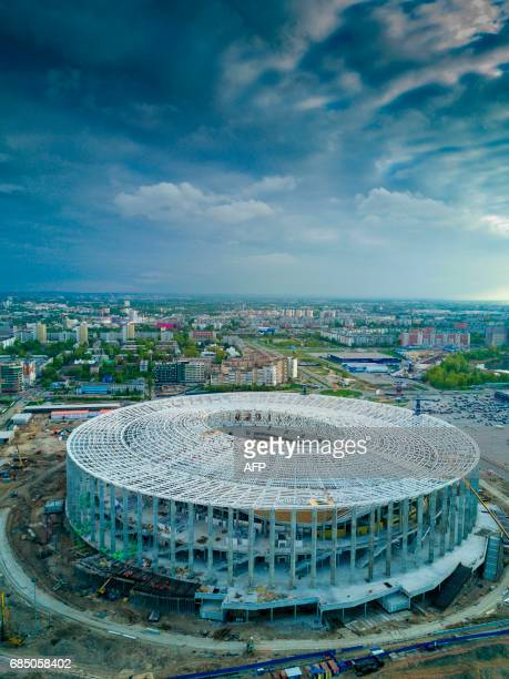 An aerial view taken on May 18 2017 shows the Nizhny Novgorod Stadium under construction in Nizny Novgorod The venue will host matches during the...