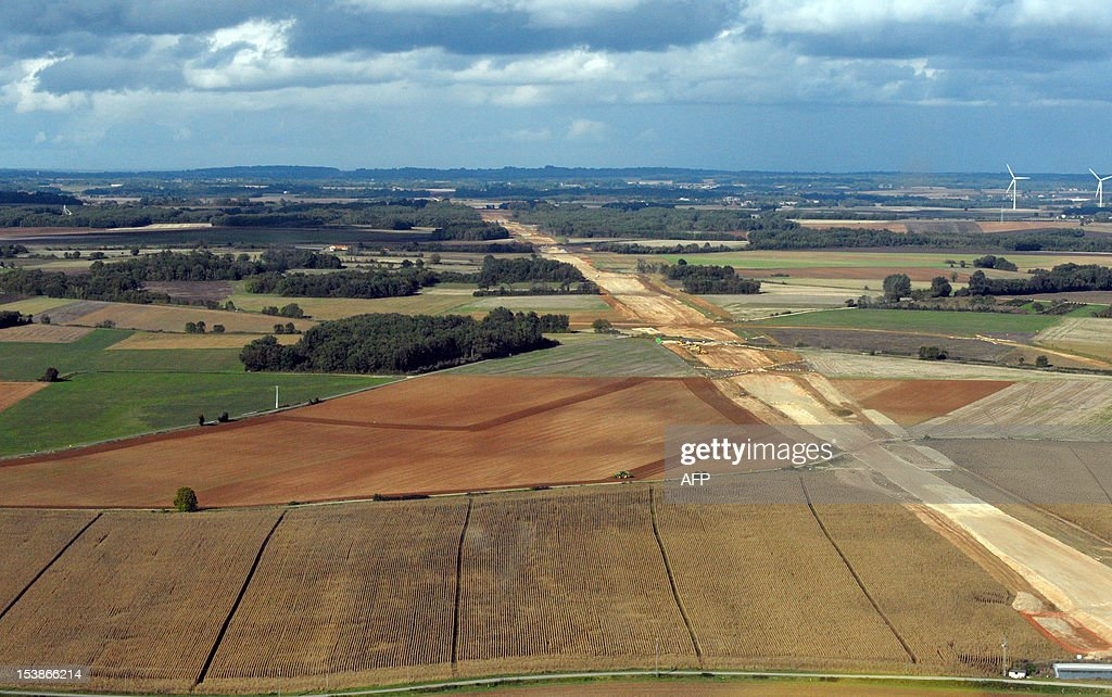 An aerial view taken on October 10, 2012 between Poitiers and Angouleme, western France, shows a track crossing fields on the contruction site of the future South Europe Atlantic high-speed rail (SEA HSR) between Tours and Bordeaux. The HSR project is 302 km long, with 38 km of connecting line to the conventional rail network and will reduce the journey time between Paris and Bordeaux to 2 hours 5 minutes.