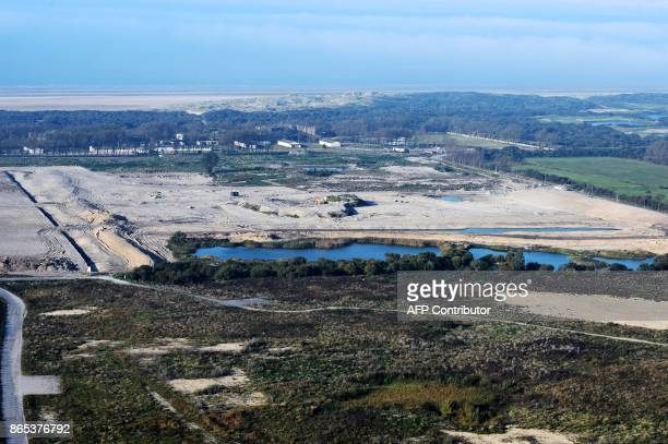 An aerial view taken on October 14 2017 shows the site of the former Jungle migrant camp that was evacuated 12 months ago in Calais A year after the...