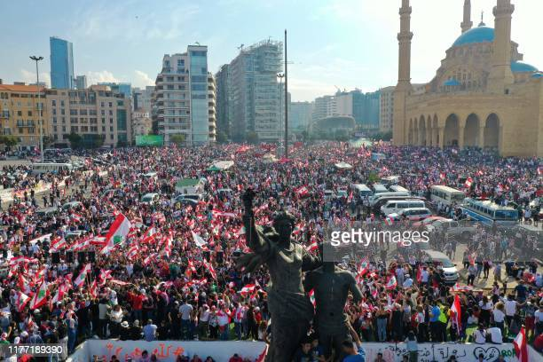 An aerial view taken on October 20 shows Lebanese protesters rallying in Martyrs' Square near the Mohammed alAmin mosque in downtown Beirut on the...