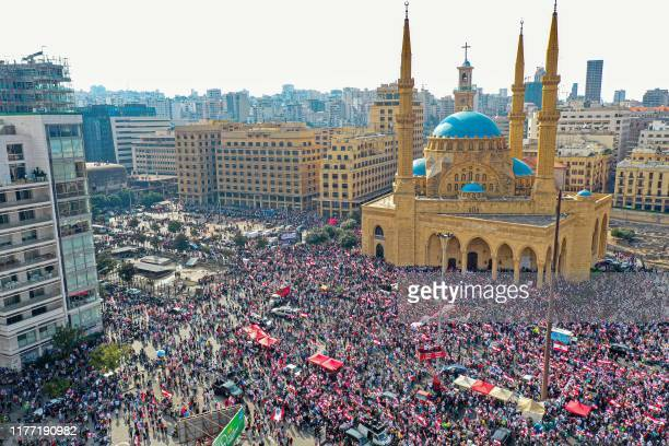 An aerial view taken on October 20 shows Lebanese protesters rallying outside the Mohammed alAmin Mosque and the nearby Maronite Cathedral of St...