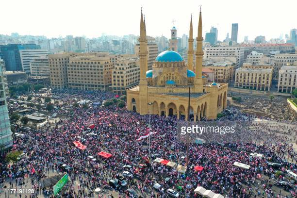 An aerial view taken on October 20 shows Lebanese protesters rallying outside the Mohammed al-Amin Mosque and the nearby Maronite Cathedral of St...
