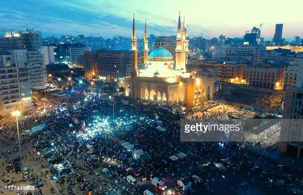 An aerial view taken on October 21 shows Lebanese protesters rallying outside the Mohammed alAmin Mosque and the nearby Maronite Cathedral of St...