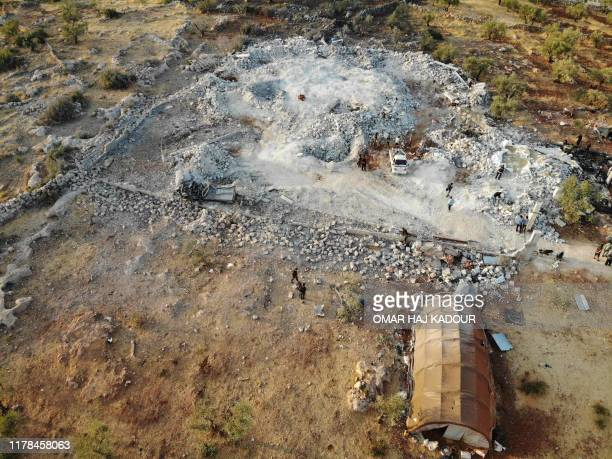 TOPSHOT An aerial view taken on October 27 2019 shows the site that was hit by helicopter gunfire which reportedly killed nine people near the...