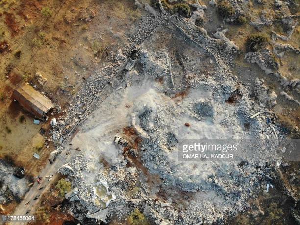 An aerial view taken on October 27 2019 shows the site that was hit by helicopter gunfire which reportedly killed nine people near the northwestern...