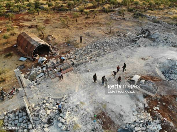An aerial view taken on October 27, 2019 shows the site that was hit by helicopter gunfire which reportedly killed nine people near the northwestern...