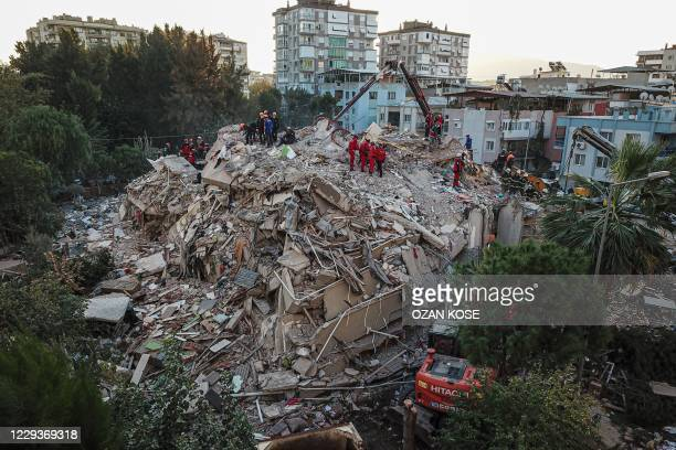 An aerial view taken on October 31 in Izmir shows Rescue workers searching for survivors in a collapsed building after a powerful earthquake struck...