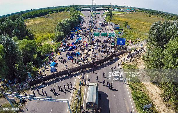 An aerial view taken on September 16 2015 shows migrants camping on noman's land of the border between Hungary and Serbia near Roeszke Hungarian...