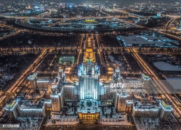 An aerial view taken with a drone in Moscow on January 27 2018 shows the main building of the Moscow State University Luzhniki Stadium and the Moskva...