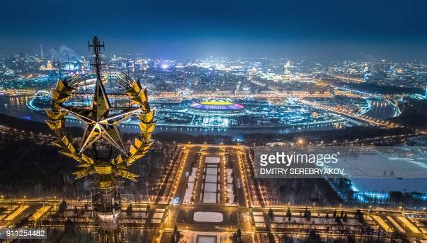 An aerial view taken with a drone in Moscow on January 27 2018 shows a star on top of the Moscow State University Luzhniki Stadium and the Moskva...