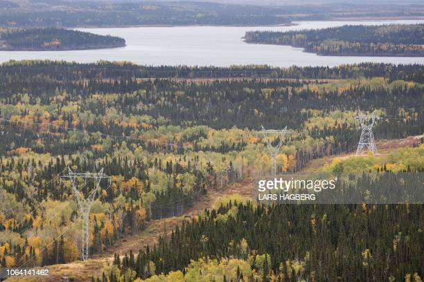 An aerial view with the Romaine river in the background and Hydro Quebec power line is seen north of Havre-St-Pierre, Quebec, October 3, 2018. -...