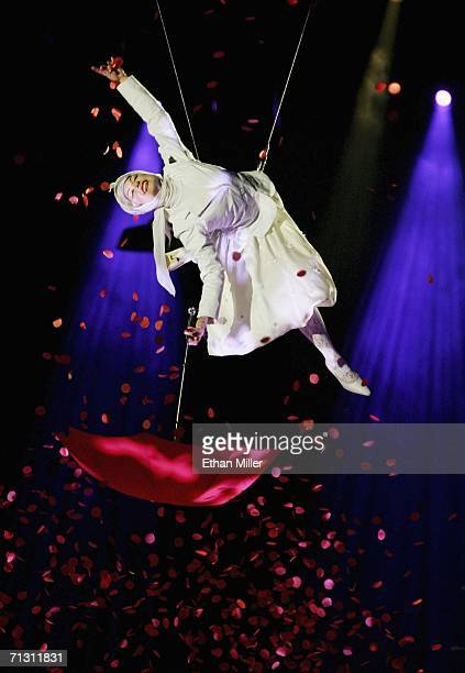 An aerialist performs during a preview of The Beatles LOVE by Cirque du Soleil at The Mirage Hotel Casino June 27 2006 in Las Vegas Nevada The show a...