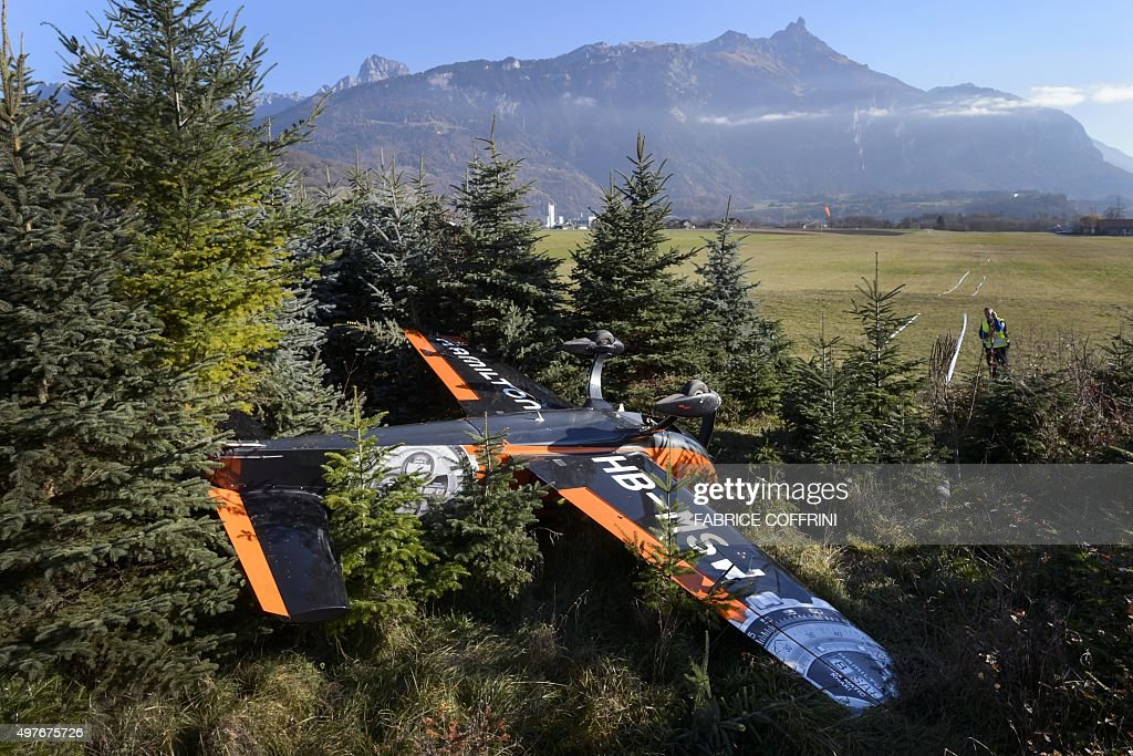 An aerobatic airplane which crashed during landing on November 18, 2015 is seen at the airdrome in Bex, western Switzerland. Two person were injured during the accident. / AFP / FABRICE
