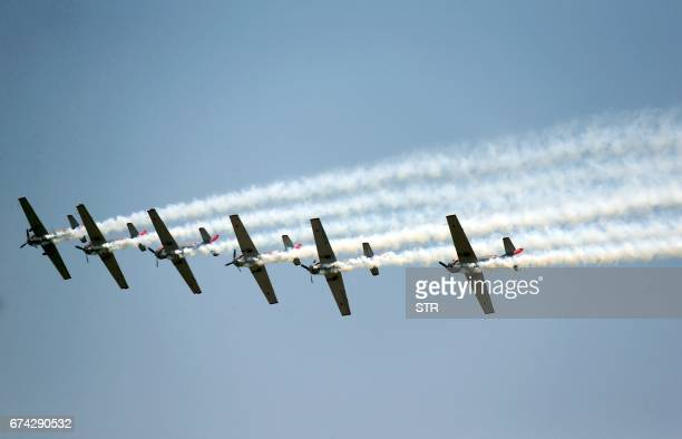 An aerobatic team performs at the Airshow Zhengzhou 2017 in Zhengzhou central China's Henan province on April 28 2017 The airshow takes place from...
