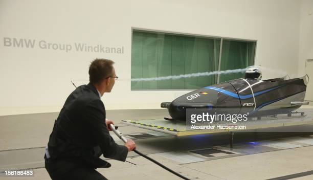 An aerodynamicist controls the aerodynamics of the new Bobsleigh FES 208 piloted by Francesco Friedrich and Alexander Mann of Team Germany 1 in the...