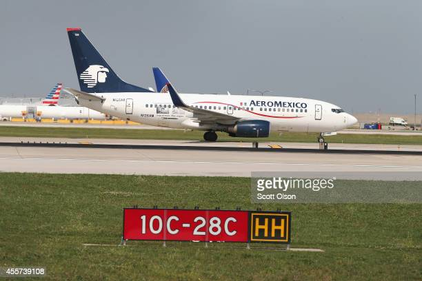 An AeroMexico jet taxis at O'Hare International Airport on September 19 2014 in Chicago Illinois In 2013 67 million passengers passed through O'Hare...