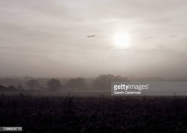 An aeroplane departs from Stansted Airport on January 27, 2021 in Stansted, United Kingdom.