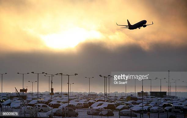 An aeroplane departs Luton airport on December 22 2009 in Luton England Adverse weather conditions of heavy snowfall have caused cancellations to...