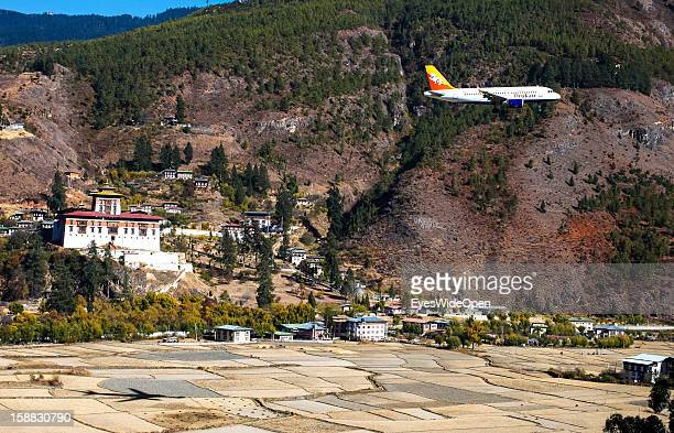 An aeroplane of the Royal Bhutan Airline Drukair on arrival at Paro Airport , one of the most dangerous airports in the world on November 18, 2012 in...