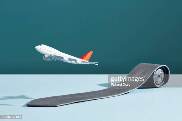 an aeroplane taking off on a runway made from a business tie - richard drury stock pictures, royalty-free photos & images