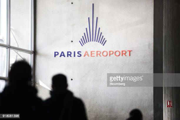 An Aeroports de Paris sign hangs on the wall inside Charles de Gaulle airport operated by Aeroports de Paris in Paris France on Monday Feb 12 2018...