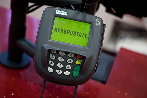 Usa business aeropostale opens flagship store in times square an aeropostale credit card reader is photographed at the brands flagship retail store in times square reheart Images