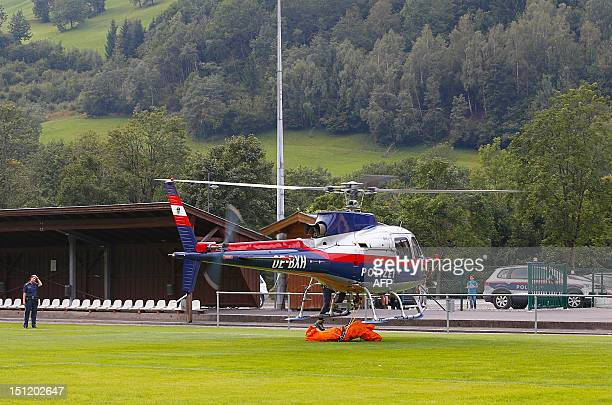 An Aerospatiale Ecureuil AS350 Police helicopter lands in Kaprun with the body of a German mountaineer who accidentaly died in the Maiskogel...