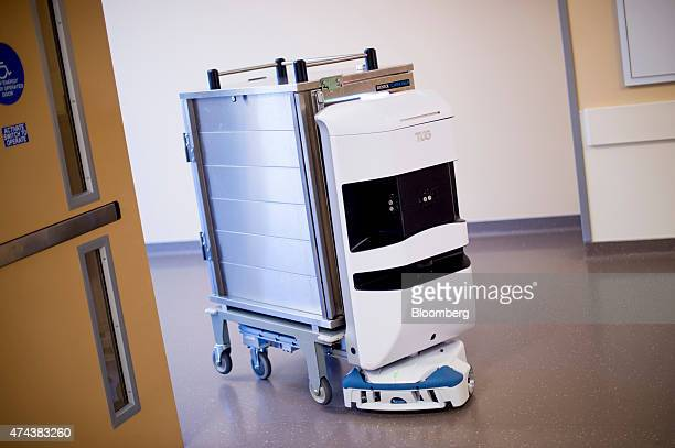 An Aethon Inc TUG robotic courier carries supplies through the University of California San Francisco Medical Center at Mission Bay in San Francisco...