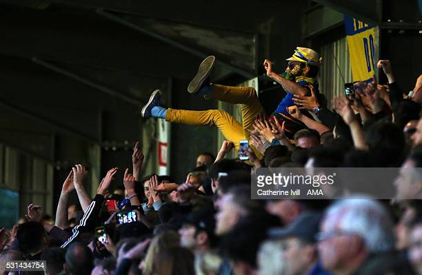 An AFC Wimbledon fan crowd surfs during the Sky Bet League Two Play Off First Leg between AFC Wimbledon and Accrington Stanley at The Cherry Red...