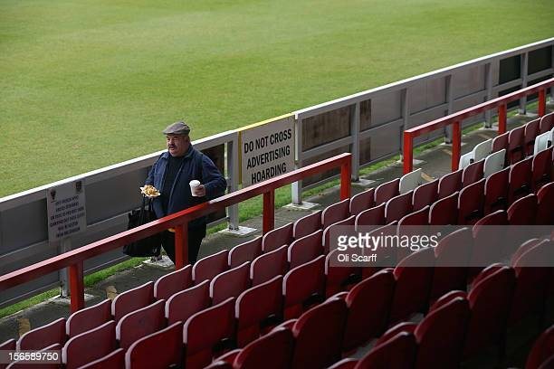 An AFC Wimbledon fan finds a position to watch the npower League Two match between AFC Wimbledon and Aldershot Town at the Cherry Red Records Stadium...
