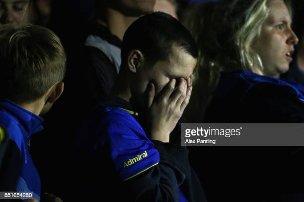 An AFC Wimbledon fan looks dejected during the Sky Bet League One match between AFC Wimbledon and Milton Keynes Dons at The Cherry Red Records...