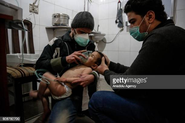 An affected child receives treatment after an alleged gas attack on Sakba and Hammuriye areas in Eastern Ghouta Syria on March 7 2018 According to...