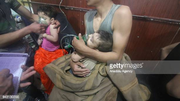 An affected Syrian child receives medical treatment after Assad regime forces allegedly conducted poisonous gas attack to Duma town of Eastern Ghouta...