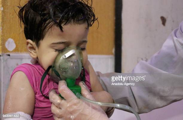 An affected Syrian kid receives medical treatment after Assad regime forces allegedly conducted poisonous gas attack to Duma town of Eastern Ghouta...