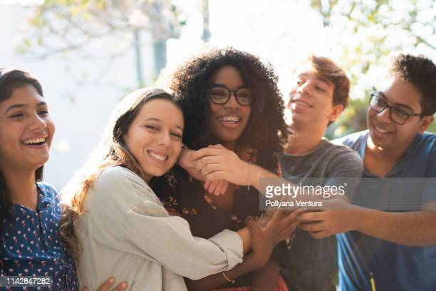 an affectionate hug of birthday - teenagers only stock pictures, royalty-free photos & images