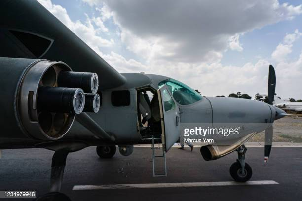 An Afghan AC208, sits disabled on the runway at the Hamid Karzai International Airport, in Kabul, Afghanistan, Tuesday, Aug. 31, 2021.