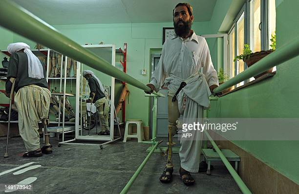 An Afghan amputee practises walking with his prosthetic leg at the International Committee of the Red Cross hospital for war victims and the disabled...