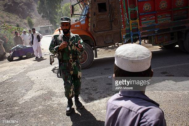 An Afghan Army soldier stands guard at the volatile border crossing with Pakistan September 11, 2006 at Torkham, Afghanistan. Five years after Al...